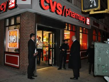 Cops investigate a robbery at a CVS on the Upper East Side.