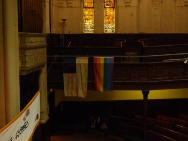 A rainbow flag has hung side by side with the Christian flag at West-Park Presbyterian for 33 years.