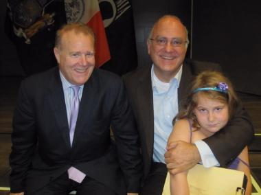 Bloomberg advisory John Feinblatt and Department of Consumer Affairs Commissioner Jonathan Mintz pose with their daughter Maeve, 8.