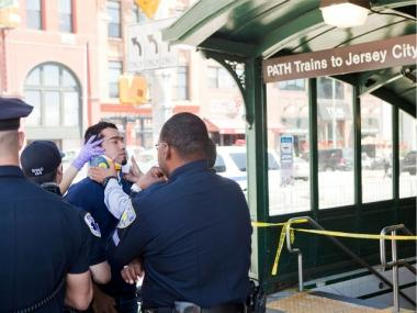 Medics tend to a victim of Sunday's PATH train crash in Hoboken.