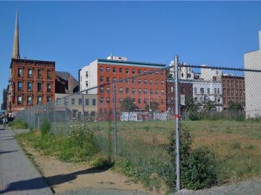 The vacant lot at West 125th Street and Lenox Avenue.