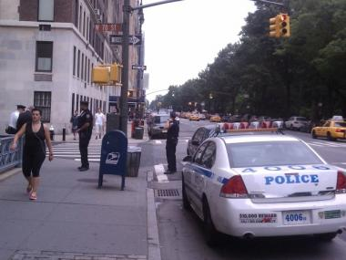 Cops investigate the scene of a mugging at 70th Street and Central Park West, one of two near the park Wednesday.