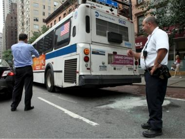 Inspectors check out the scene of an accident involving an M15 bus on 53rd Street and First Avenue Wednesday afternoon.