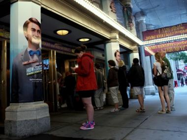 Theatergoers wait Thursday to buy tickets to
