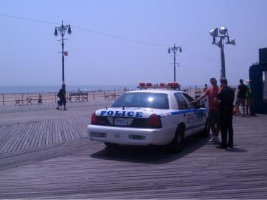 Police seen on the boardwalk in Brighton Beach the day after a Harlem teen was gunned down.