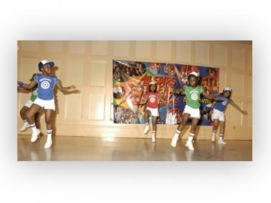 Tysha Jones (in blue at left) and Cheyenne Baez (in blue at right) dancing together as part of Harlem's Angels in 2004 at an All Stars Talent Show.