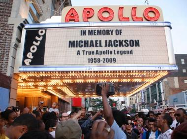 The Apollo Theater's marquee memorializes pop star Michael Jackson as crowds of fans gather outside to remember him on June 25, 2009.