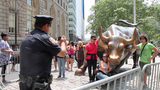 Police Officer Posted at Wall Street Bull Doubles as Tourist Photographer