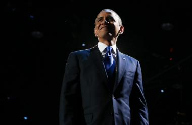 U.S. President Barack Obama stands on stage after his victory speech at McCormick Place November 6, 2012 in Chicago, Illinois.