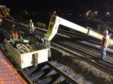Construction crews work on the Red Line tracks at the Loyola CTA station platform in Rogers Park.