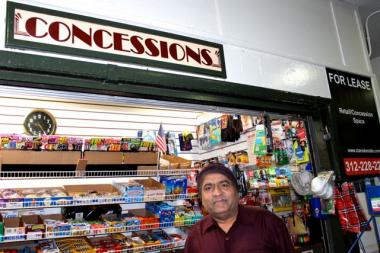 "A ""For Lease"" sign hangs next to ""Concessions"" inside Dash Patel's 80-square-foot stand at the Damen Blue Line ""L"" stop."