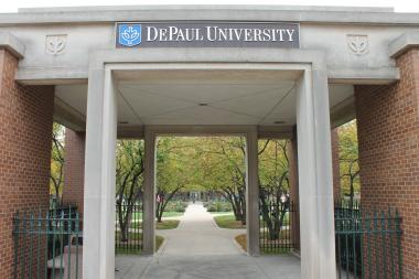 A DePaul University student reported that he was struck in the back of the head by two men while walking home from the school's fitness center Monday night.