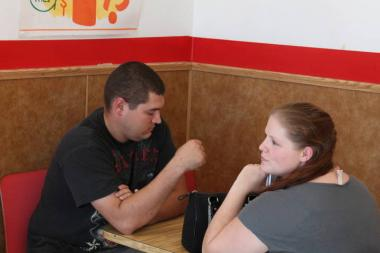 Robert and Ashley Fortag wait on their large sausage pizza order at the Reggio's Pizza restaurant at 120 W. 87th St.