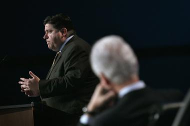 J.B. Pritzker makes a speech to an audience including Bill Clinton earlier this year.