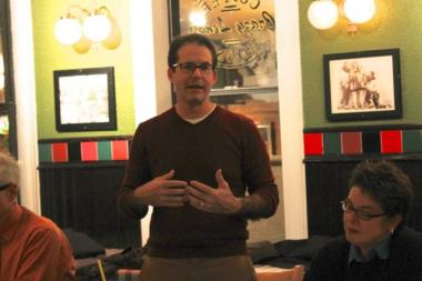 Neal McKnight of the East Village Association spoke with a group of neighbors at a strategy meeting in advance of the city hall finance committee meeting. Oct. 8, 2012.