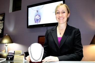Rebecca Dohe stands at the counter of Radiance Fine Jewelry, which she's owned since 2006.