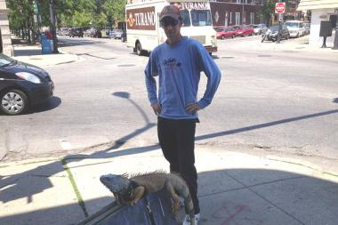 Samie Kennedy and his pet red iguana Zilla frequently take walks in the Bridgeport neighborhood.