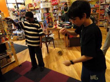 Children play with yo-yos at Cat & Mouse Game Store, Fall 2011 in Bucktown.