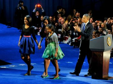President Obama takes the stage with wife Michelle and daughters Malia (left) and Sasha during his Election Night rally at McCormick Place in 2012.