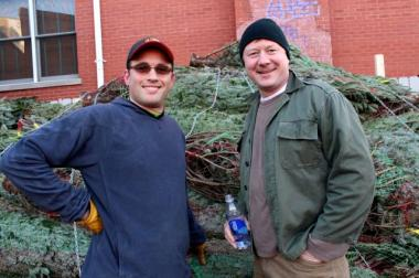 On Thanksgiving, Chris Hohenstein (left) and James Dombrowski prepared City Tree Delivery for its opening day of business the following day. The full-service tree lot, adjacent to Big Star, 1531 N. Damen, will sell, deliver and set up trees through Dec. 23. The company will even come back after Christmas to take the tree for recycling.