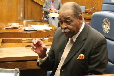 Commissioner William Beavers, seen here at a Cook County Board meeting, is on federal trial for allegedly cheating on his taxes. Attorneys in the the case made openning statements Thursday.