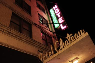 Hotel Chateau's owner, Jack Gore, is being sued by the city for building code violations.