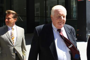 Former Chicago police Cmdr. Jon Burge walks with members of his legal team into the Dirksen U.S. Courthouse, Monday, June 28, 2010, in Chicago, Illinois. Burge was convicted on all counts of an indictment charging him with perjury and obstruction of justice. (Photo by Alex Garcia/Chicago Tribune/MCT via Getty Images)