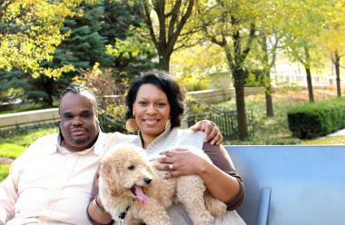 Nicole and John Anthony of Chatham with their 3-year-old Golden Doodle Maestro, whom they adopted from a friend in Washington who was breeding and selling puppies to fund an in-vitro fertilization procedure. The Anthonys considered in-vitro fertilization before deciding on adoption, which they say is less expensive and more reliable option.