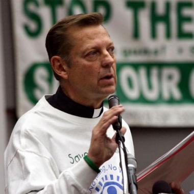 A woman was arrested Sunday for allegedly stalking the Rev. Michael Pfleger for a third time.