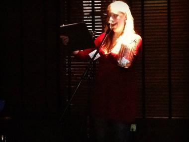 A storyteller takes to the mic at a recent Story Club: South Side event.