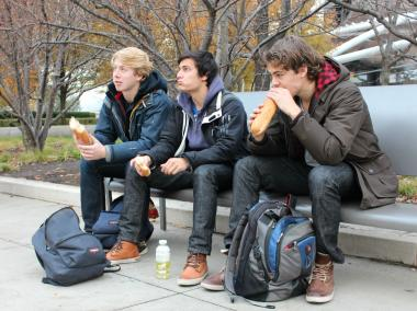 (From left) Melchior Huijts, 20, Freerick Van den Oudenalder, 20, and Max Roest, 21, of the Netherlands, eat sandwiches for a late lunch outside Monday. The three traveled to Chicago while on break from studying at Iowa State University in Ames, Iowa.