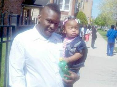 Terrance Steele, 32, was allegedly killed by his girlfriend's mother April 9 in his Humboldt Park home, authorities said. Here, Steele is pictured with his 1-year-old daughter, Tyra.
