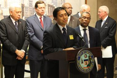 Backed by Chicago aldermen, Lawrence Benito, head of the Illinois Coalition for Immigrant and Refuee Rights, argues in favor of temporary driver's licenses for undocumented immigrants at City Hall on Thursday.