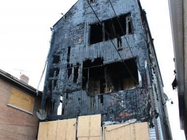 A look at the rear exterior of a three-story apartmenrt building that caught fire early Tuesday.