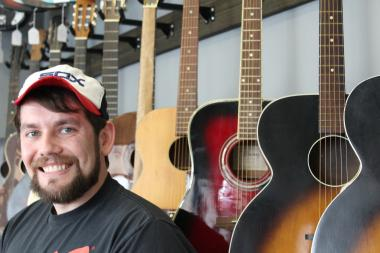 Bob Dain, 26, opened 312 Vintage Guitars, 754 W. 35th St., in December, offering local musicians a new shopping option on the South Side.