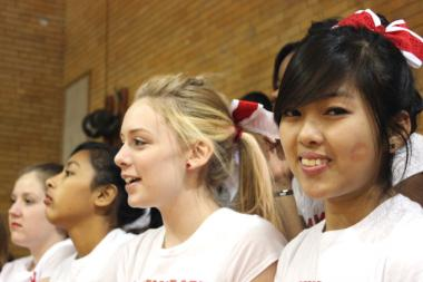 Amundsen cheereleaders root on a performance by the school's poms squad.