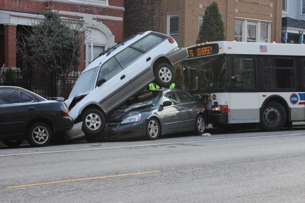 A CTA bus crashed into several parked cars near Kedzie and Diversey.