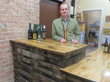 Chris Quinn stands at the tasting counter of his new Avondale shop, the Beer Temple, 3185 N. Elston Ave.