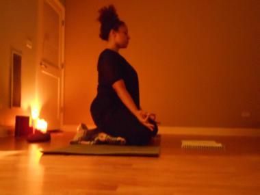 Instructor Nicole Gutierrez leads a class of candlelight yoga at In Motion Yoga, 821 W. Superior St.