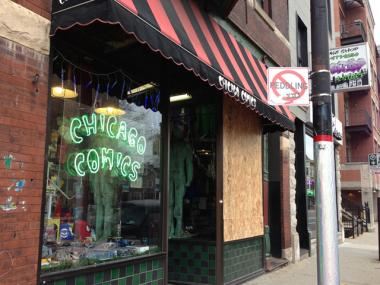 A man flew face-first into Chicago Comic's storefront Saturday during an annual holiday pub crawl. The store boarded up the window until it can be replaced.