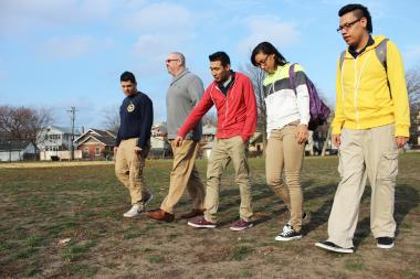 Chicago Math and Science Academy seniors, from right, Alexis Castro, 18, Amanda Hyde, 17, Cesar Ayala, 19, and Pedro Rayes, 17, walk in Touhy Park alongside their social studies teacher Tom Stonis, 39.