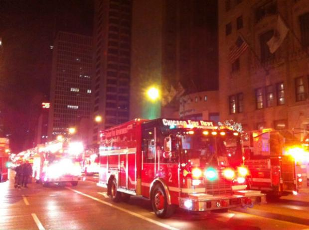 Fire trucks clog North Michigan Avenue early Thursday after a man fell down a chimney at the Intercontinental Hotel. He was rescued but was pronounced dead at 5:15 a.m.