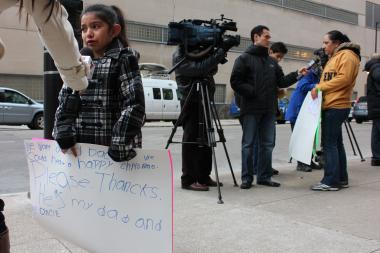 Dozens of Chicagoans demonstrated outside the Department of Homeland Security to bring attention to the impact deportations have on family life.