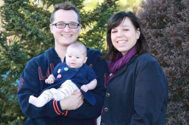 Eric Cwik, 27, is joined by his daughter, Eva Sophia, 3-months old, and wife, Stephanie, in a family photo.