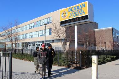 An 18-year-old Dunbar High School basketball player was shot Monday night in Englewood after boarding a school bus, police said.