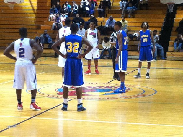 After one Dunbar High School basketball player was injured in a shooting Monday, the team played against Curie Metro High School Tuesday, losing 68-41.