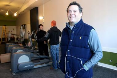 Freddie Wolner, 44, owner of My Time Fitness, oversees delivery of cardio equipment Saturday. The storefront gym at 2117 N. Damen Ave plans to open in January and will offer 24-hour access 365 days a year.