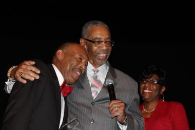 (from left) Edward Calahan shares a laugh with U.S. Rep. Bobby Rush (D-1st) Saturday, Dec. 1, 2012 as he presents him with a Lifetime Achievement award, while Calahan's wife Shirley looks on.