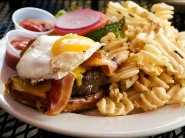 Foodie website The Daily Meal has declared Kuma's Corner's Kuma Burger, with its layers of cheddar, bacon and a fried egg, as the country's top beef patty combo.