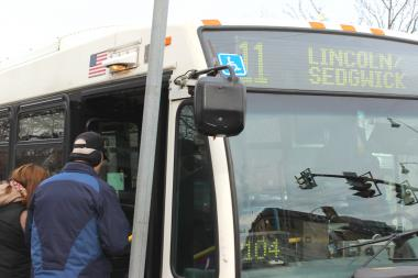 Riders board the #11 Lincoln Avenue bus at Montrose Avenue, a stop that will be eliminated if a CTA plan takes effect as scheduled Dec. 16.